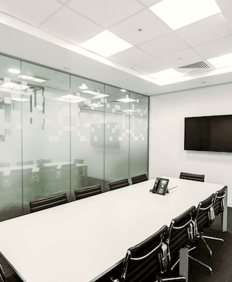 rectangular meeting room with glass panes behind
