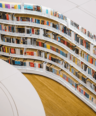 curved view of books in book shelves
