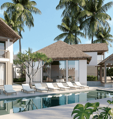 elegant thatch roofed house overlooking a crystal clear modern pool